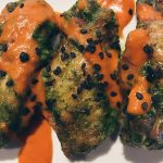 Chimichurri chicken wings garnished with salsa roja, black sesame seeds, and homemade ranch dressing on white plate from Silver in Bethesda MD